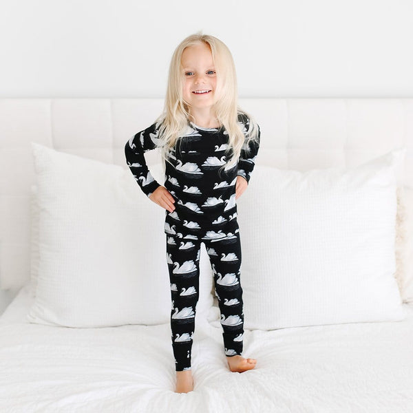 Toddler wearing Leia Long Sleeve Pajamas with swan pattern