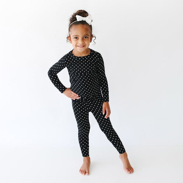 Toddler wearing Lilly Long Sleeve Pajamas with polka dots pattern