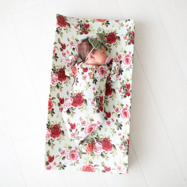 Baby lying on Lizzie pad cover