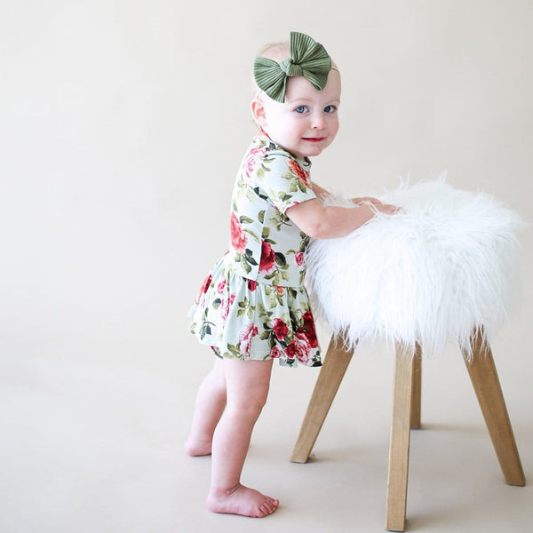 Standing baby on Lizzie short sleeve twirl skirt bodysuit