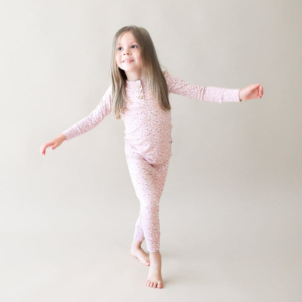 Toddler wearing Maevis long sleeve henley pajamas