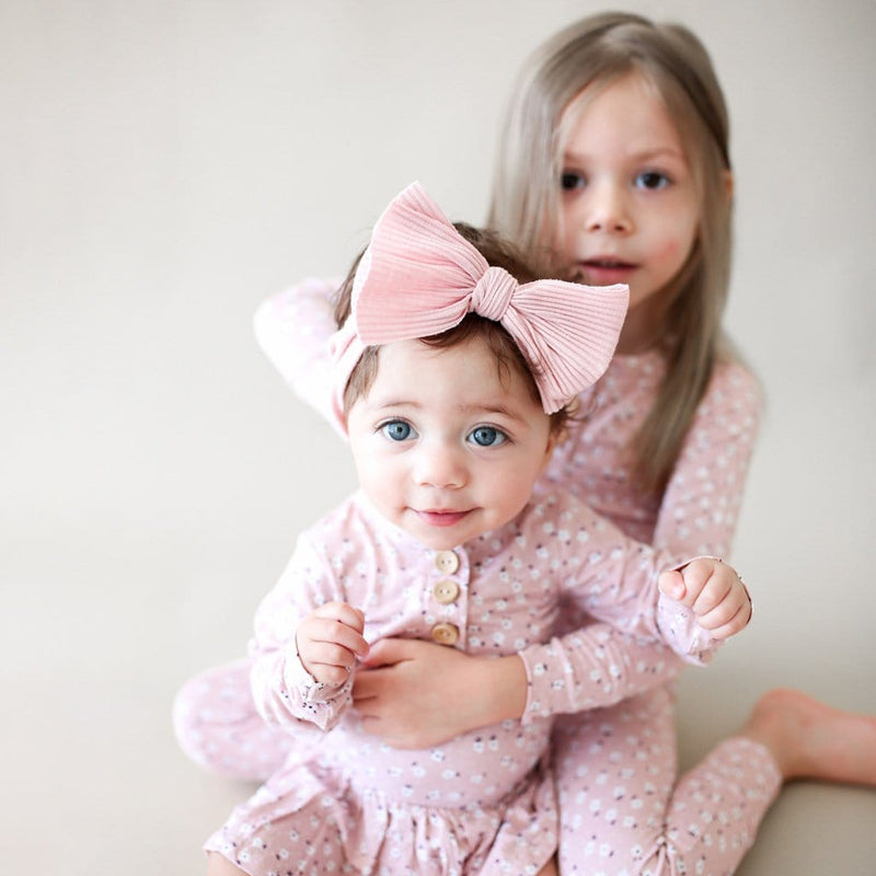 Toddler with sister wearing Maevis long sleeve henley pajamas