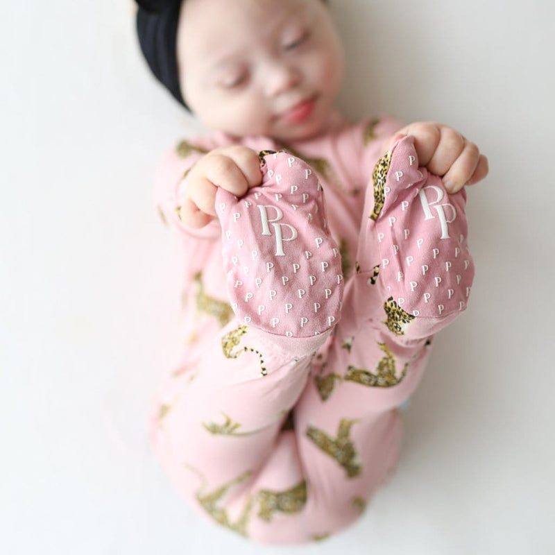 Baby on Mara footie Ruffled zippered one piece close up