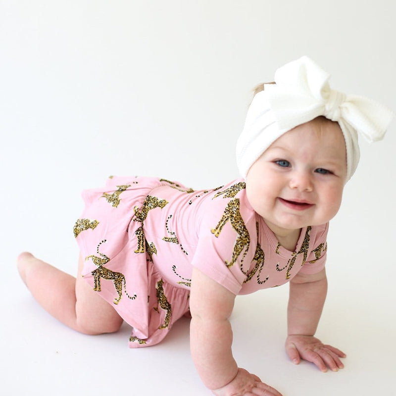 Baby crawling on Mara short sleeve twirl skirt bodysuit