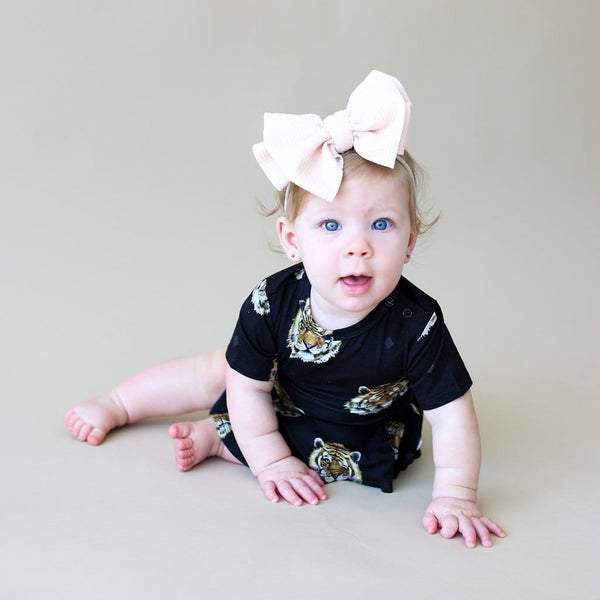 Baby sitting wearing Mateo short sleeve twirl skirt bodysuit