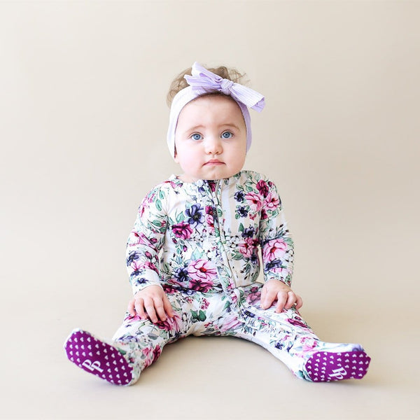 Baby wearing Melina Footie Ruffled Zippered One Piece