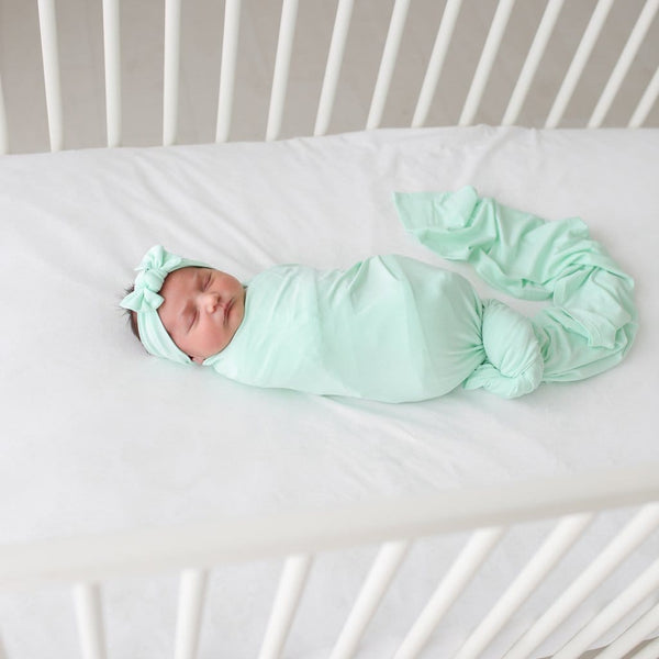 Baby wearing mint swaddle headband set