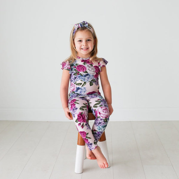 Toddler wearing Monroe ruffled cap sleeve pajamas