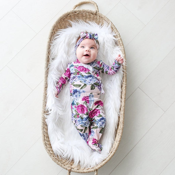 Baby on basket wearing Monroe ruffled kimono set