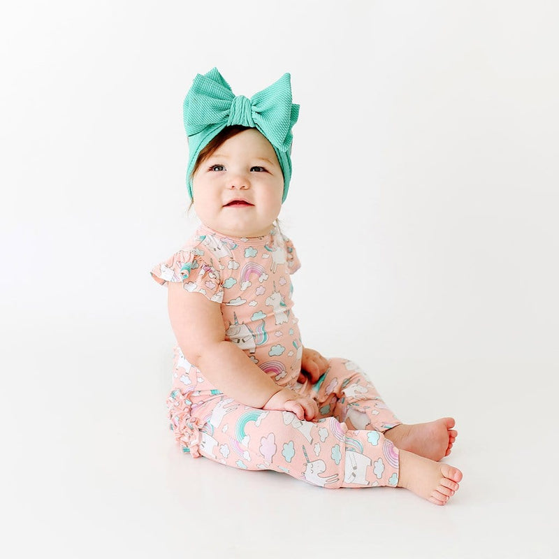 Baby on Olive Ruffled Cap Sleeve Romper with unicorn pattern