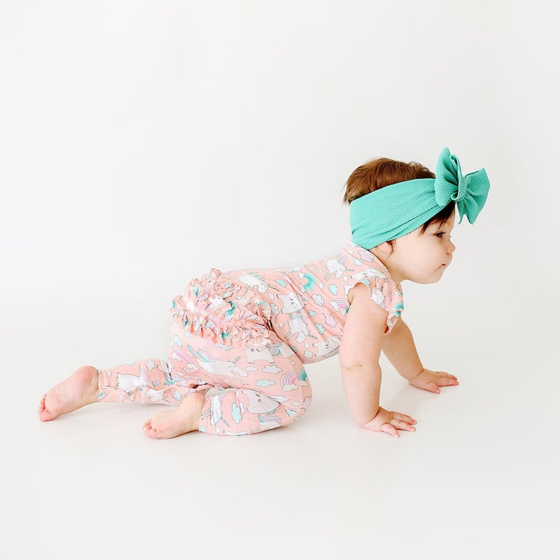 Crawling baby wearing pink Olive Ruffled Cap Sleeve Romper