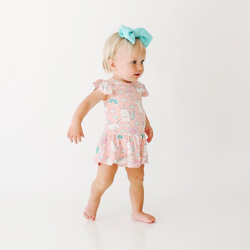 Walking baby wearing Olive Ruffled Cap Sleeve Twirl Skirt Bodysuit with unicorn pattern