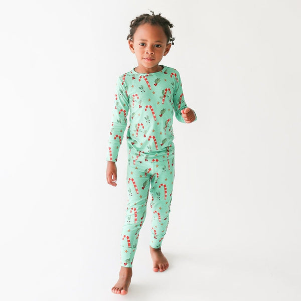 Toddler wearing Peppermint Long Sleeve Pajamas with candy cane print