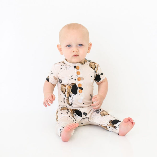 Baby sitting wearing Perry short sleeve henley romper