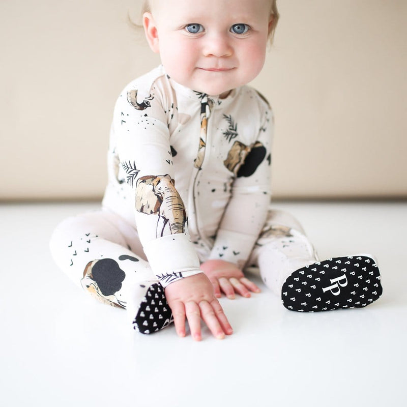 Baby close-up wearing Perry footie zippered one piece