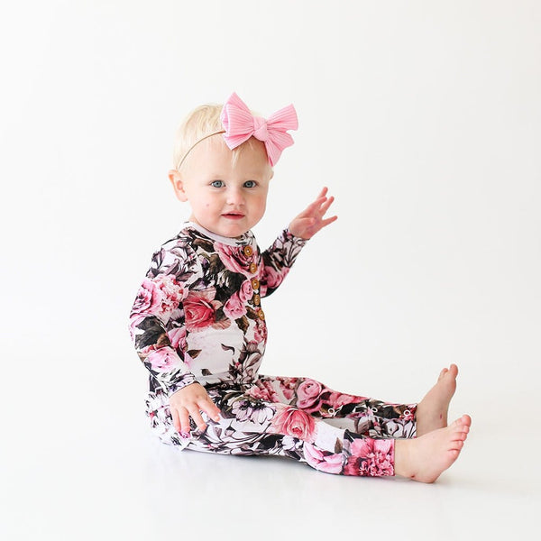 Baby wearing Rima Pink Floral Long Sleeve Ruffled Henley Romper