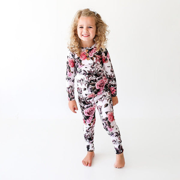 Girl wearing Rima Pink Floral Long Sleeve Henley Pajamas