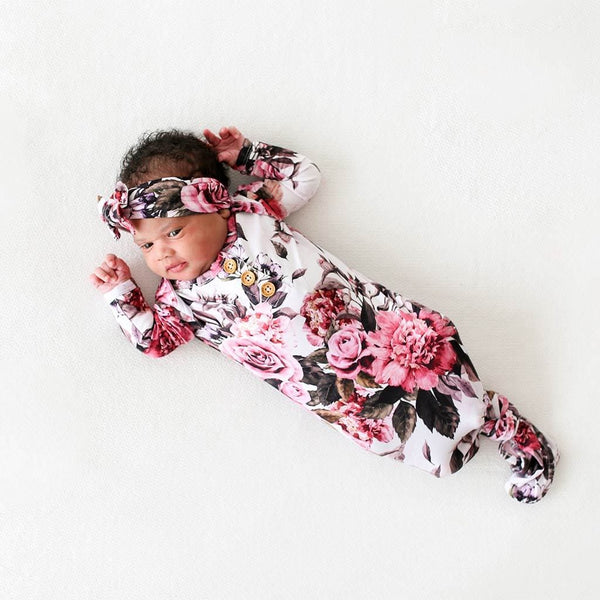 Baby wearing Rima Pink Floral Button Knotted Gown