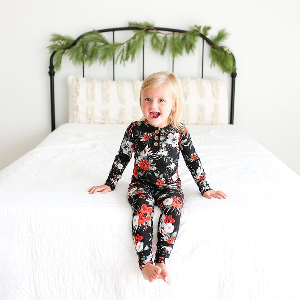 Girl toddler wearing Rowena Black Floral Long Sleeve Henley Pajamas