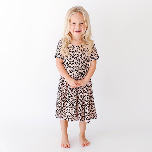 Toddler wearing Samara Short Sleeve Twirl Dress with jaguar pattern