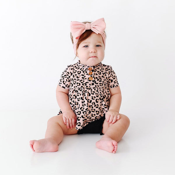 Baby on Samara Short Sleeve Henley Peplum with jaguar pattern Ruffled Bummie Set