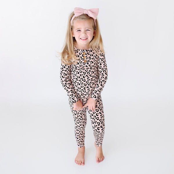Toddler wearing Samara Long Sleeve Henley Pajamas with jaguar pattern