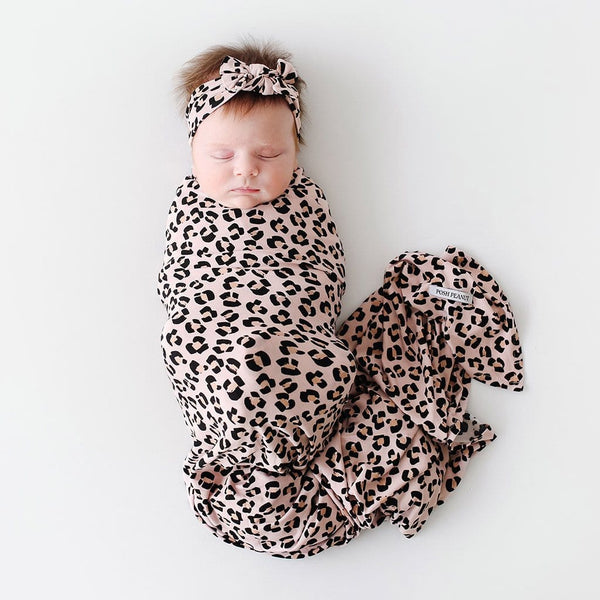 Baby wearing Samara Swaddle Headband Set with jaguar pattern