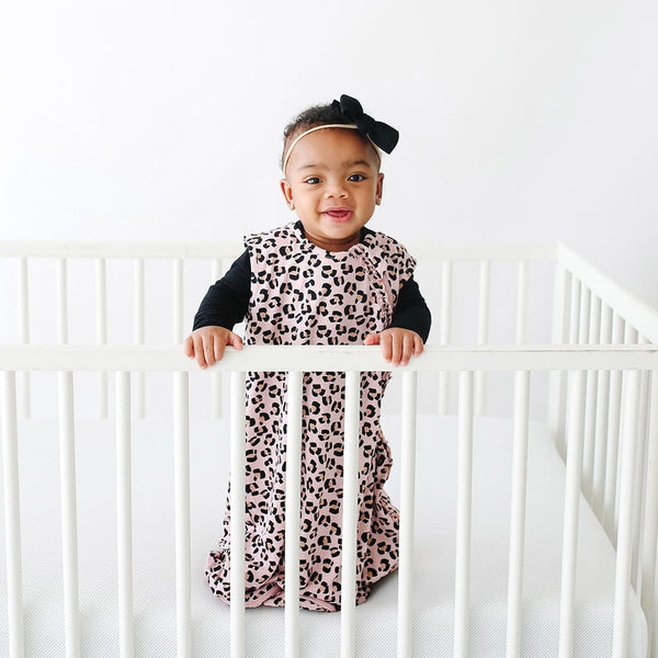 Baby wearing Samara Sleeveless Ruffled Sleep Bag 0.5 Tog with jaguar pattern