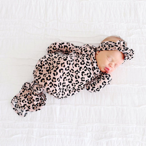 Baby wearing Samara Knotted Gown with jaguar pattern