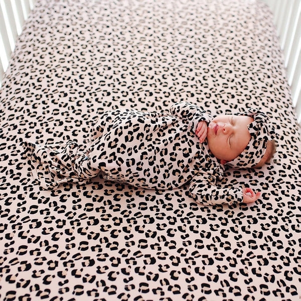 Baby on Samara Crib Sheet with jaguar pattern