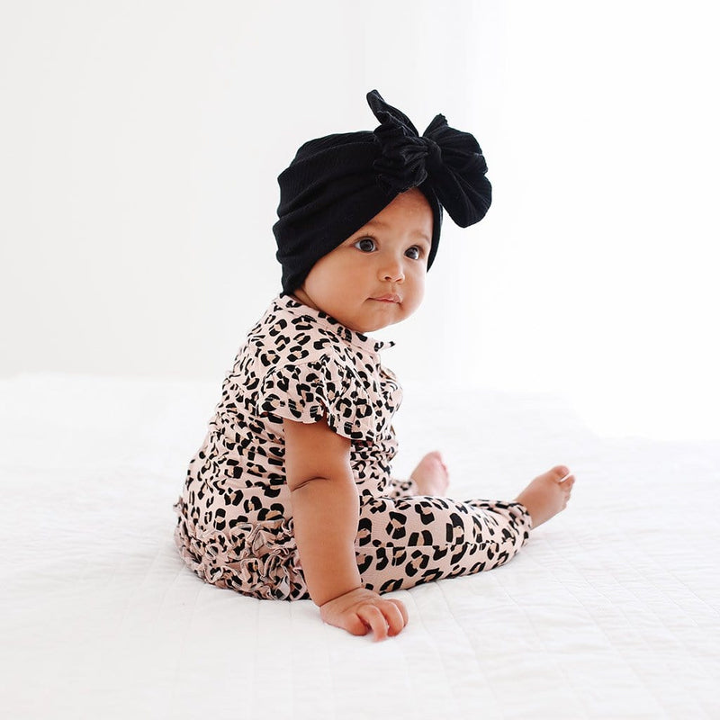 Baby on Samara Ruffled Cap Sleeve Henley Romper with jaguar pattern