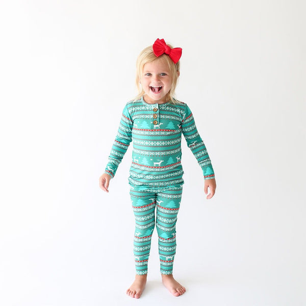 Toddler girl wearing Sebastian Long Sleeve Henley Pajamas in blue and red print