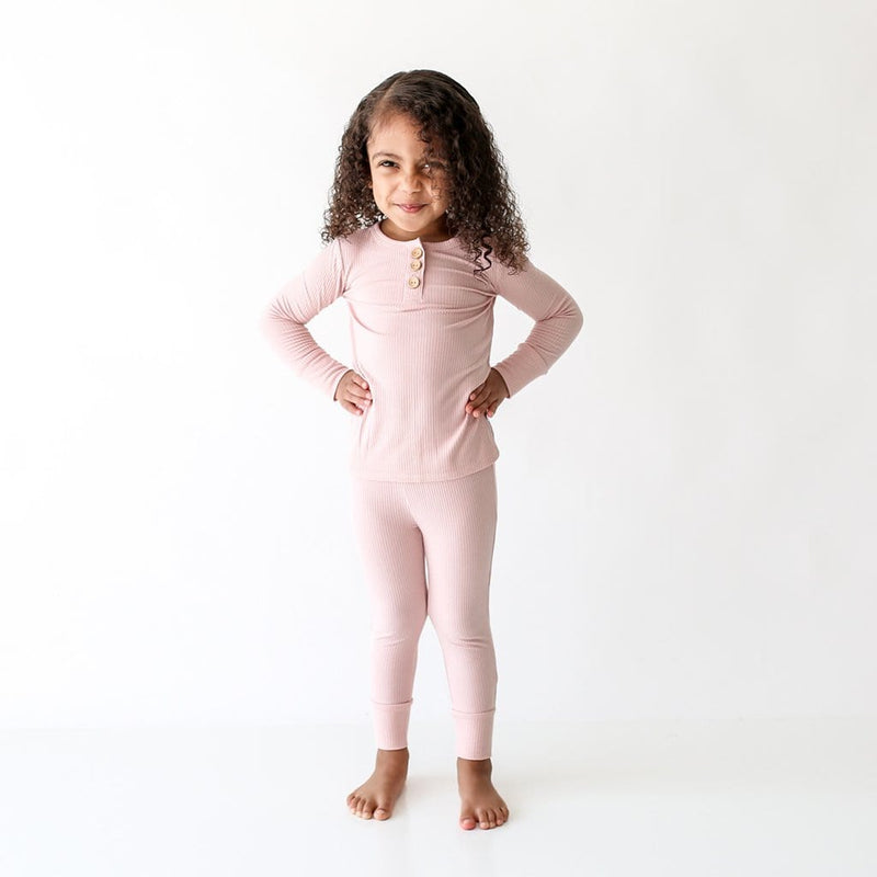 Baby standing wearing Sweet Pink Ribbed Long Sleeve Henley Pajamas