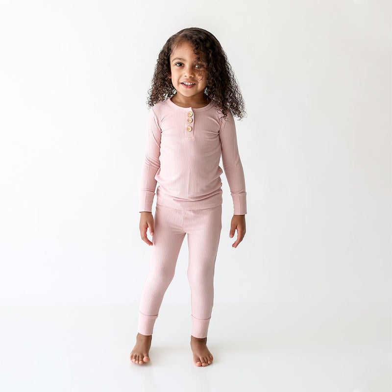 Toddler wearing Sweet Pink Ribbed Long Sleeve Henley Pajamas