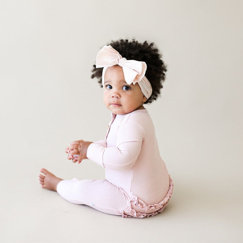 Sitting baby wearing Sweet Pink Ribbed Long Sleeve Ruffled Henley Romper