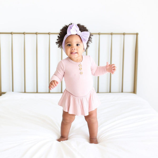 Baby wearing Sweet Pink Ribbed Long Sleeve Henley Twirl Skirt Bodysuit