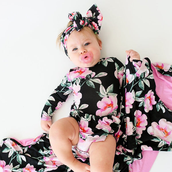 Baby on pacifier wearing Tenni Long Sleeve Twirl Skirt Bodysuit