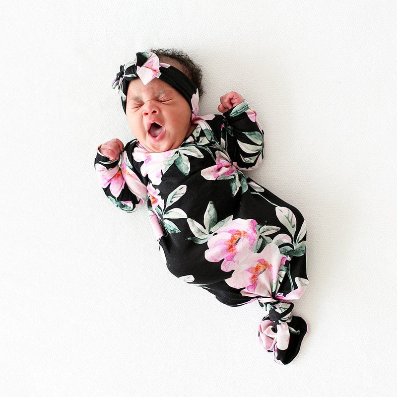 Yawning baby on Tenni Knotted Gown