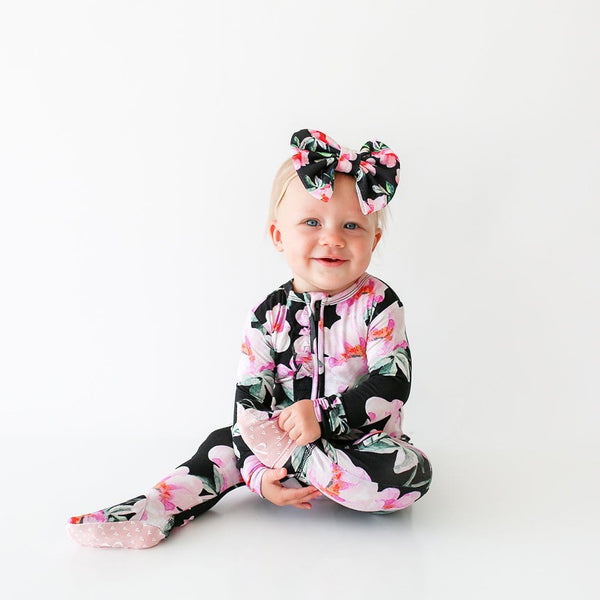 Sitting baby wearing Tenni Footie Ruffled Zippered One Piece