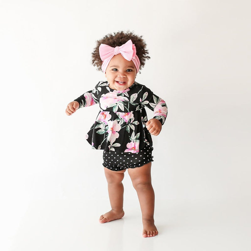 Standing baby wearing Tenni Long Sleeve Peplum Ruffled Bummie Set