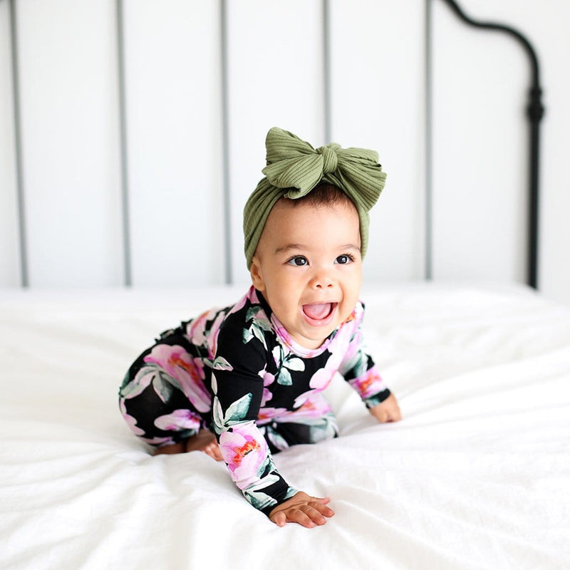 Baby on bed wearing Tenni Long Sleeve Ruffled Romper