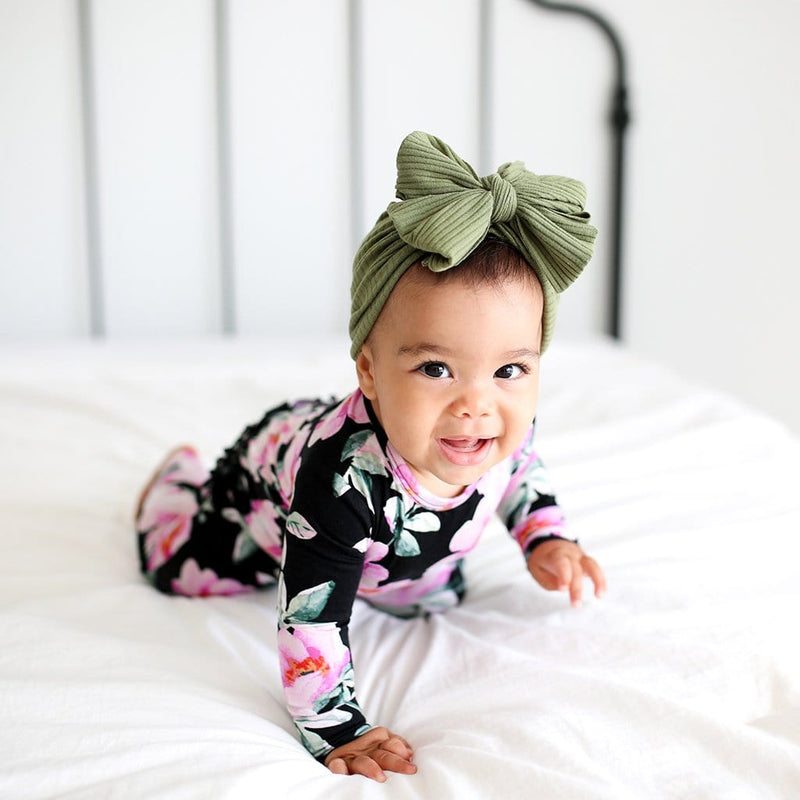 Baby crawling on bed wearing Tenni Long Sleeve Ruffled Romper