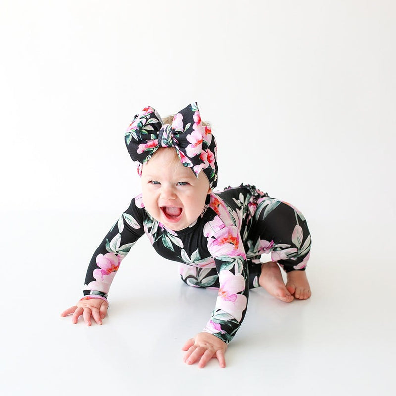 Laughing baby wearing Tenni Long Sleeve Ruffled Romper