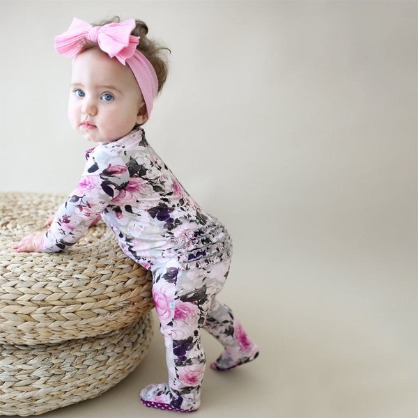 Baby playing wearing Tessa Footie Ruffled Zippered One Piece