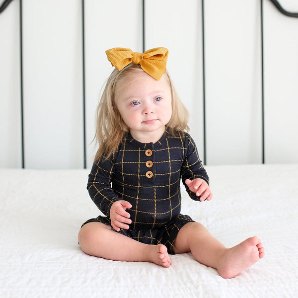 Baby wearing Tucker Long Sleeve Henley Twirl Skirt Bodysuit