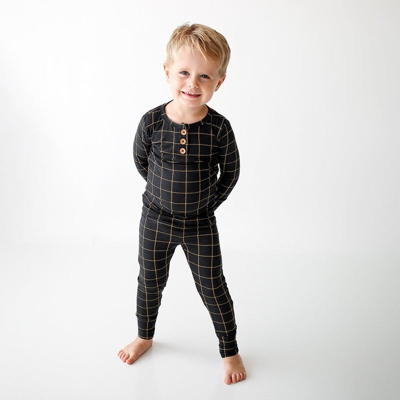 Toddler wearing Tucker Long Sleeve Henley Pajamas