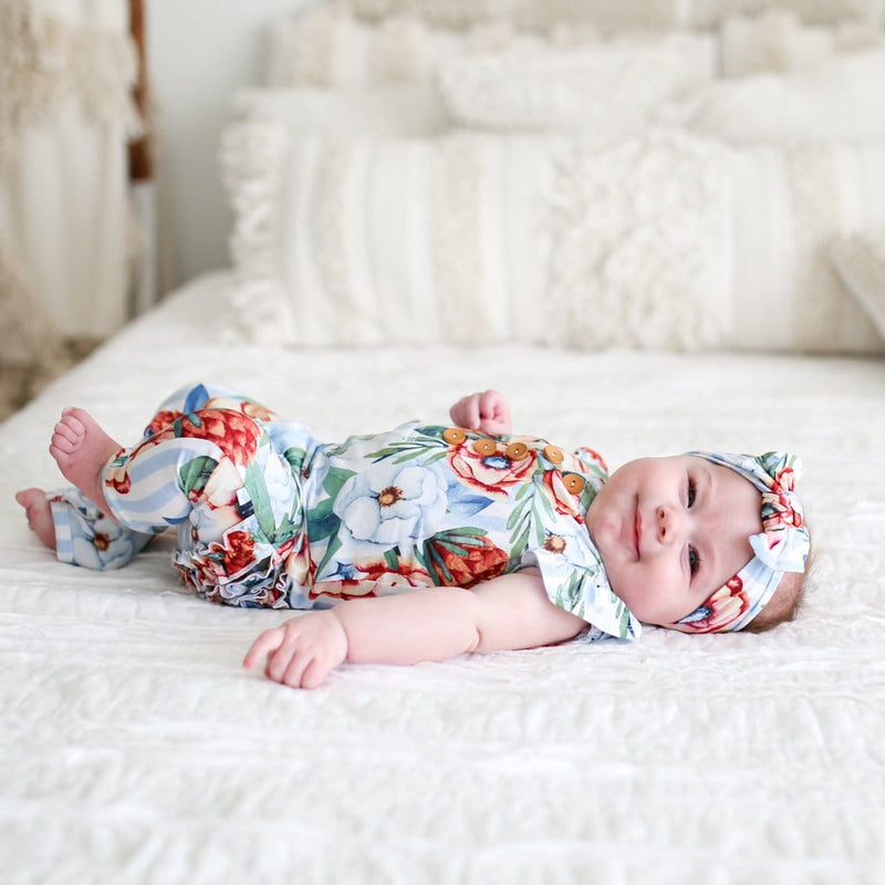 Baby on side wearing Victoria  ruffled cap sleeve henley romper