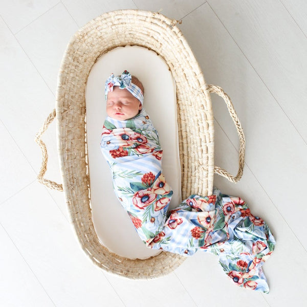 Baby on basket on Victoria swaddle headband set