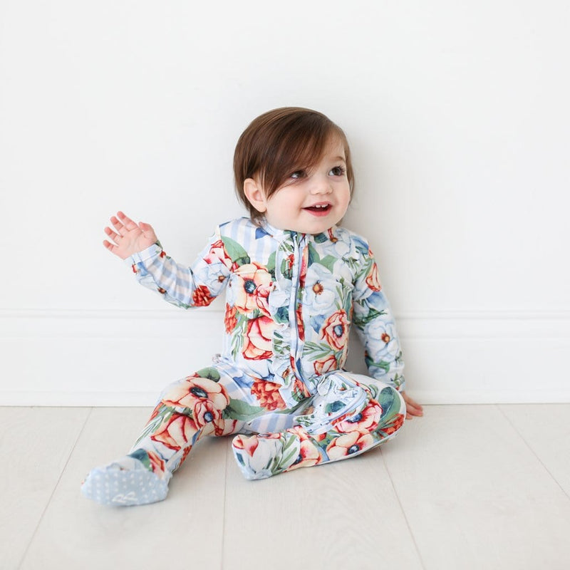 Baby wearing Victoria footie ruffled zippered one piece