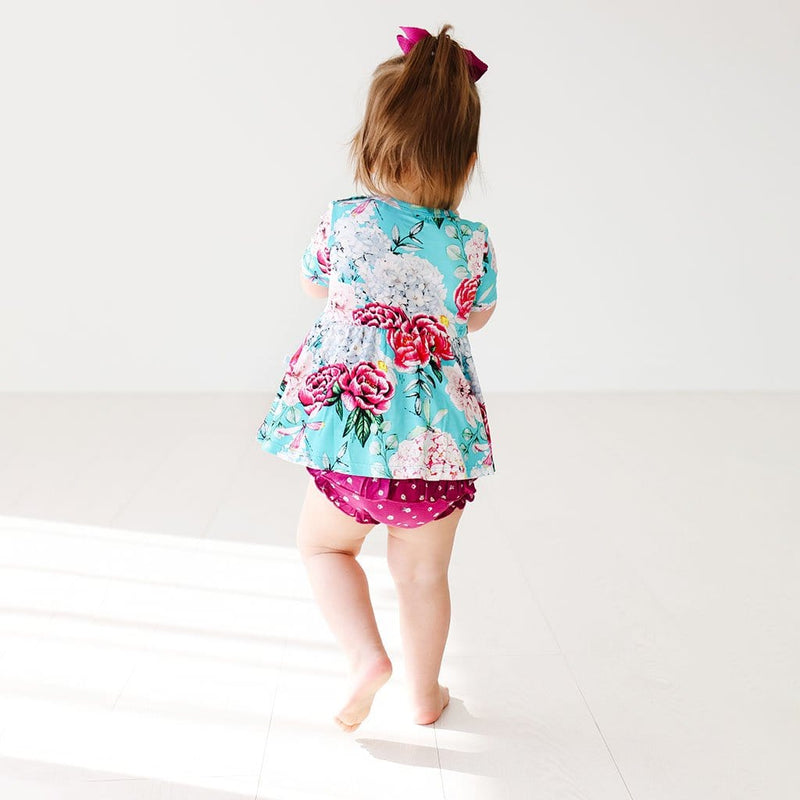 Baby wearing Eloise Short Sleeve Peplum Ruffled Bummie Set back side